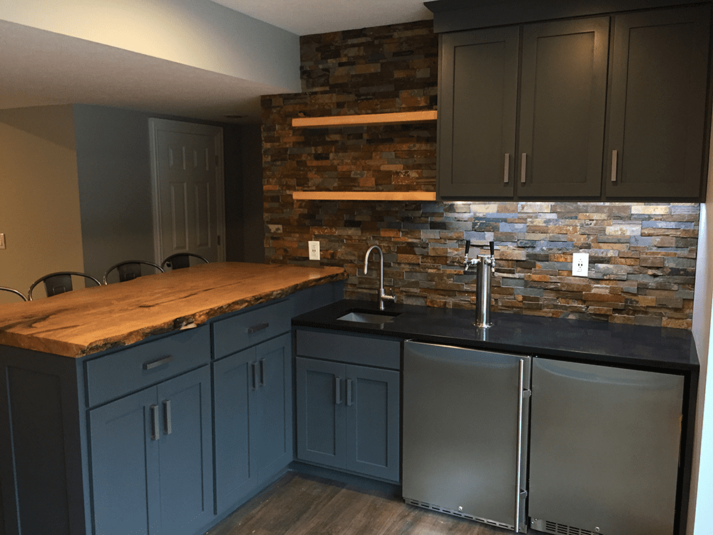 kitchen with dark blue and gray cabinets and wooden countertops