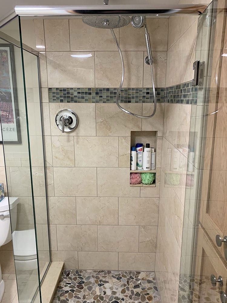 walk in shower with rain shower and large brown tile