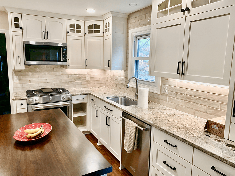 kitchen with off white cabinets and wooden top island