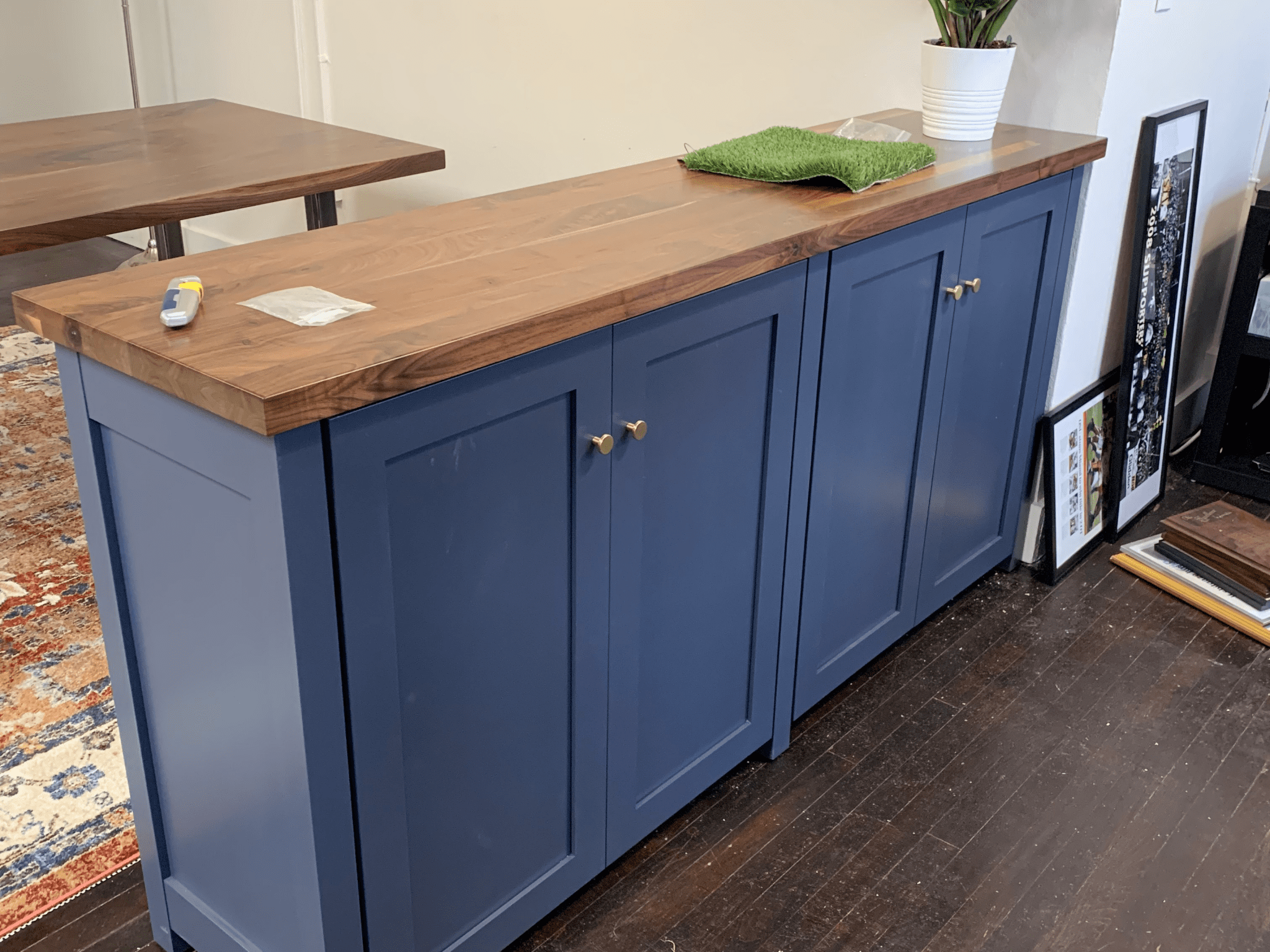 navy blue living room cabinets with wooden countertop