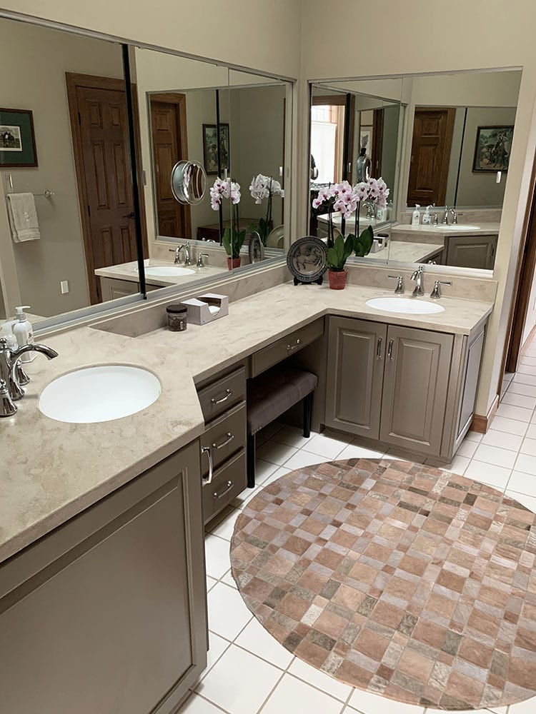 master bathroom light brown cabinets and orchid on counter