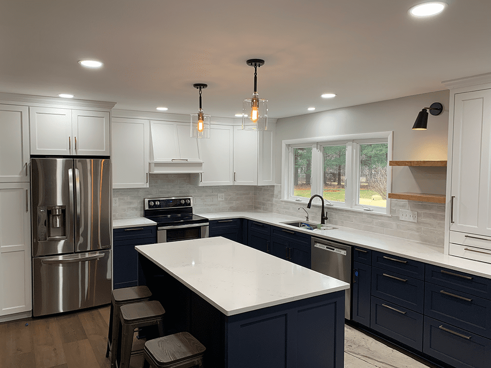 kitchen with white cabinets dark blue drawers and white and blue island