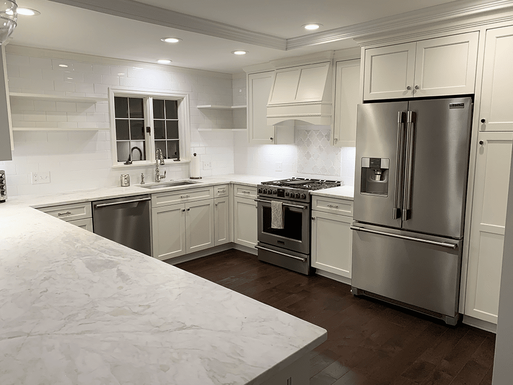 kitchen with off white cabinets and floating shelves on one wall