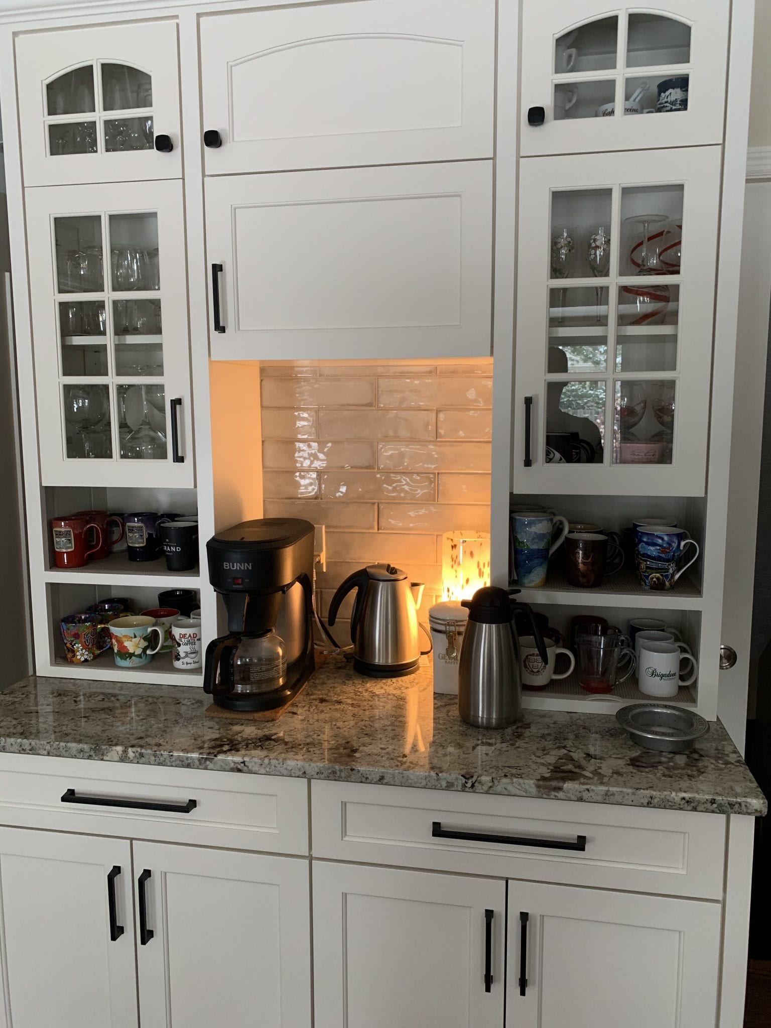 kitchen nook with coffee pot and decor on top