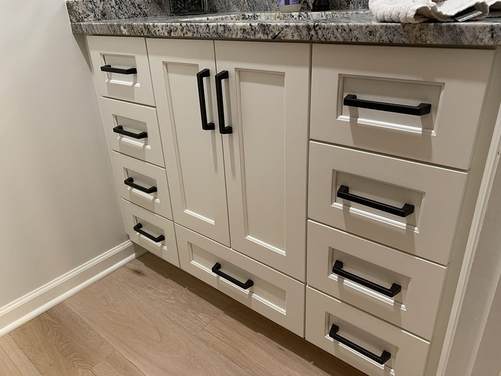 white floor amish cabinets with black handles